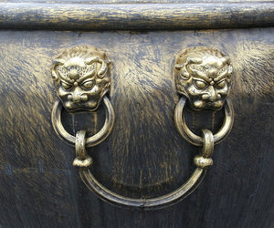 Urn handle: Ornamental handle of a large scraped gold urn in the Forbidden City, Beijing, China.