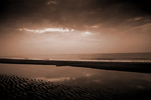 beach: cloudy beach in sepia