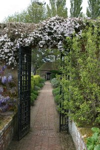 Garden gate: A gated path in a garden in Somerset, England.