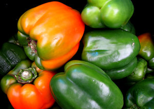 capsicums: green and orange capsicums - bell peppers
