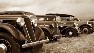 Classic cars in sepia: Vintage cars in a row