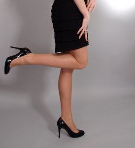 Woman with high heels, one kne