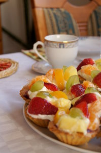 delicious dessert: cakes with fresh fruits and cream