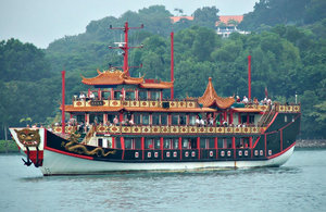 Chinese tourist war ship: passengers taking a short cruise on a Chinese tourist war ship