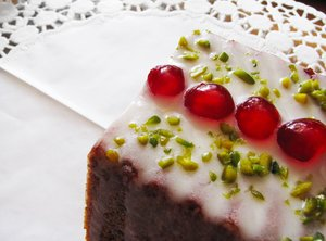 iced cake 2: Cake with icing, sugared cherries and pistachios