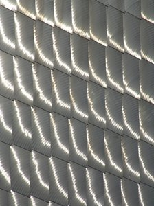Metal Fish Scales: The New England Aquarium in Boston was designed to resumble fish scales of sorts with a modern design on the outside of the building. This makes a great backgound or screen saver.