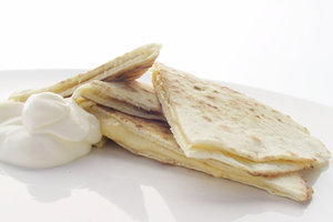 quesadilla 1: homemade quesadilla with cheese and sour cream.
