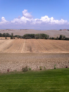 tuscany fields and clouds