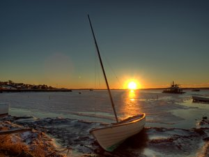 Boat on icy water - HDR