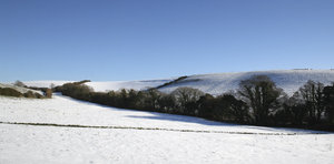Devon landscape: Snowy hillside fields in Devon, England.