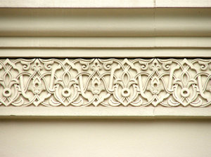 Islamic architectural frieze: external stylized fleurs-de-lis wall frieze