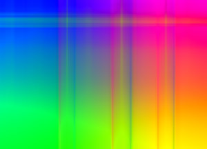 Rainbow Blur Background 2: A colourful background or fill in rainbow colours with streaks.
