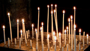 Candlelight: In the church. Candles lit for dear souls.