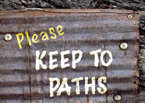 rusty sign3: rusty directional sign on old rustic wood