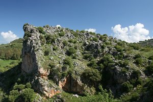 Rock outcrop: A rocky bluff beside a mountain road in Andalucia, Spain.