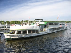 pleasure boat: A pleasure boat on the landing stage of Wannsee in Berlin, Germany