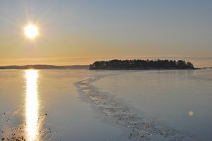 Northern Sun: Sun reflection at frosty and sunny day. Western Finland