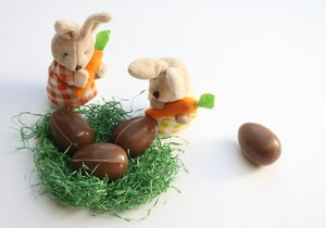 Easter Bunnies 3: Bunnies looking in a easter basket with chocolate eggs. One seems to be missing
