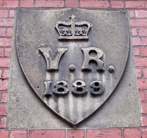 when Victoria was Queen1: dated wall stone of historic building constructed during the reign of Queen Victoria