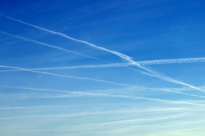 Skytracks: Tracks from airplanes on a blue sky.