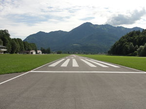 Airstrip Runway: looking down a runway towards mountains in the background