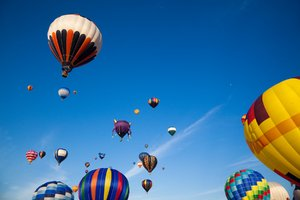 Hot Air Balloons: Hot air balloons in flight, from an annual festival in Saint-Jean-sur-Richelieu, Quebec (Canada).