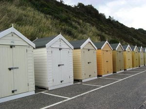 Beach huts: Multi-coloured beach huts along Bournemouth beach.
