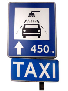 Taxi and car wash sign: Taxi and car wash. Poland.