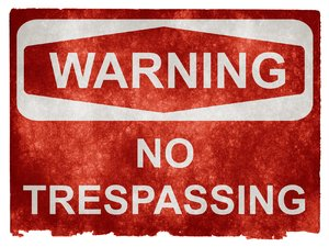 Grunge Warning Sign: Grunge textured warning sign on vintage paper, with the words NO TRESPASSING.