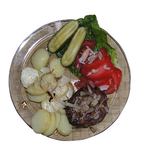 Dinner: A dinner - frikadeller with potatoes, pickles and tomatoes.