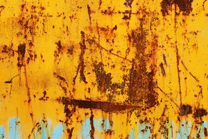 rusty metal: rusted painted metal