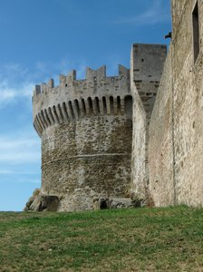 medieval tower and stone walls: Medieval tower and stone city walls, near the ancient necropolis of Populonia.
