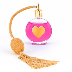 Love Potion: Vintage perfume bottle isolated on a white background, with a gold heart overlay for a more romantic feel.