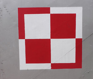 Polish Air Force checkerboard: The Air Force checkerboard is a national marking for the aircraft of the Polish Air Force, equivalent to roundels used in other nations' air forces.