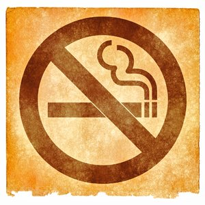 No Smoking Grunge Sign: Grunge textured No Smoking sign on vintage paper, with sepia toning for a more aged feel.
