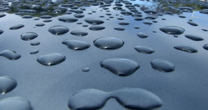 rained on2: raindrops accumulating on hard surface