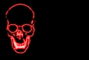Skull 9: Spooky halloween image made from a public domain image of a skull. Red neon light against a black background and plenty of copyspace. Could be used as an invitation.
