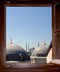 Open window, Istanbul: View of the rooftops of monuments and mosques from an open window