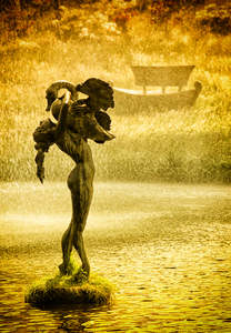 Lady and swan: Lady and swan (bronze) in the rain