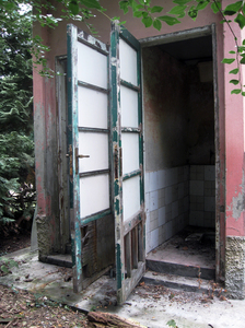 doors of abandoned toilets: doors of the abandoned toilette of a little railway station