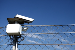 Monitoring camera: Monitoring camera and security fence