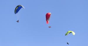 Hang-gliders: Hang-gliders over the South Downs, West Sussex, England.