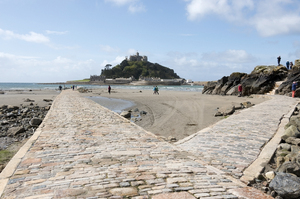 Causeway: A causeway, partially submerged, on Marazion beach leading to St. Michael's Mount, Cornwall, England.