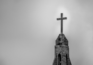 Grunge church spire: Grunge B&W church spire with a cross mounted at very top. Photo taken late afternoon in local town in Northern NSW Australia.