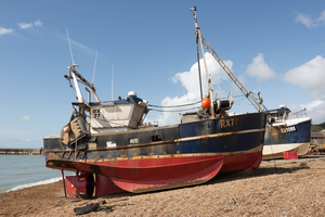 Fishing boats: Trawlers pulled up onto the beach (because there is no harbour) at Hastings, East Sussex, England. Photography in this area was freely permitted.