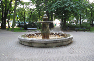 Fountain: An old stone fountain in a park in Busko-Zdrój.