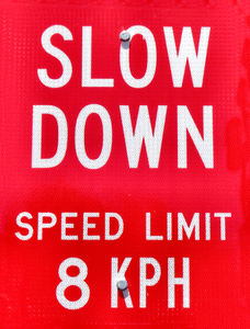 slow speed1: reflective slow speed sign in vehicle and pedestrian area