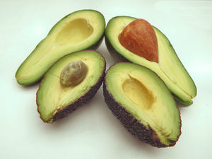 avocada varieties3: ripe avocados of varying shapes, sizes, colours & textures - cross section, seed  and seed impression