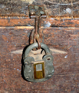 historic padlock1: old historic padlock on locked trunk – secure padlock – insecure hasp & staple
