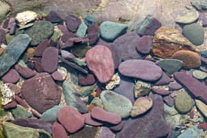 Underwater pebbles: Pebbles underwater in a rock pool on the coast of Cornwall, England.